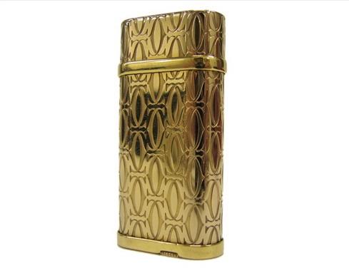 Bật lửa Cartier màu vàng logo