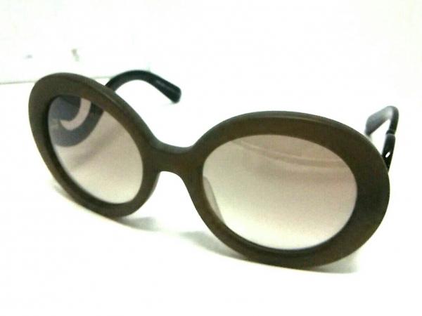 Kính mắt Prada UBU-400 màu xám nâu