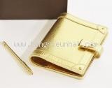 Bọc sổ tay Louis Vuitton màu vàng