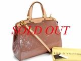 Túi xách Louis Vuitton brea GM kem hồng M90067