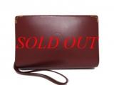 Túi cầm tay Cartier màu nâu