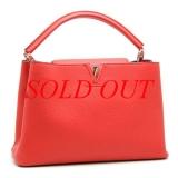 Túi Louis Vuitton Capucines MM cam hồng M94412