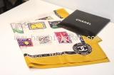 MS Khăn Chanel vàng logo